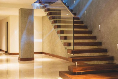 canal Walnut cantilever 'floating' staircase with glass balustrade and stainless steel handrail.