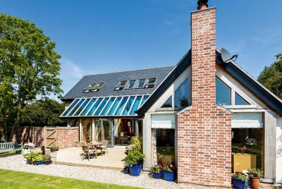 sips and oak frame home with brick chimney