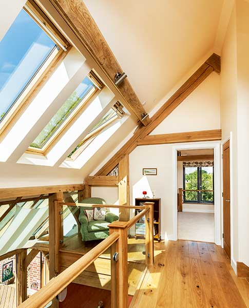 galleried landing oak frame home with rooflights