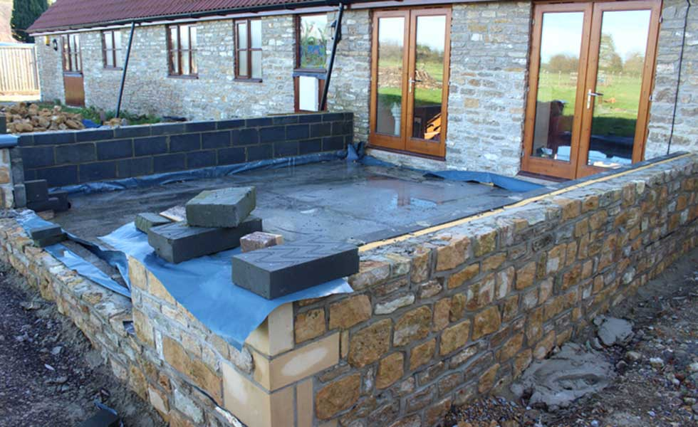 blockwork extension clad in stone