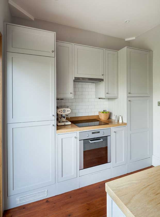 The kitchen exhibits modern and traditional features