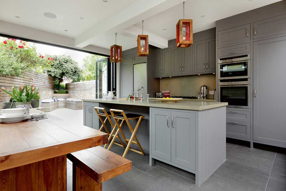 open bi fold door kitchen extension with industrial style fittings