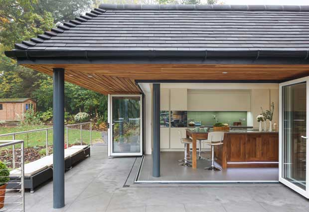 african teak overhang and bi fold doors on kitchen extension
