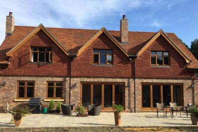 Manorwood joinery three peak house bi-fold doors brown timber frame