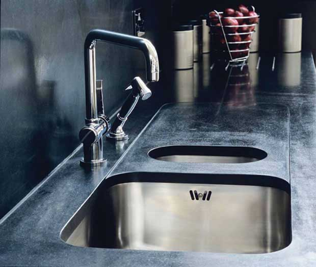 stainless steel sink teamed with black granite worktop