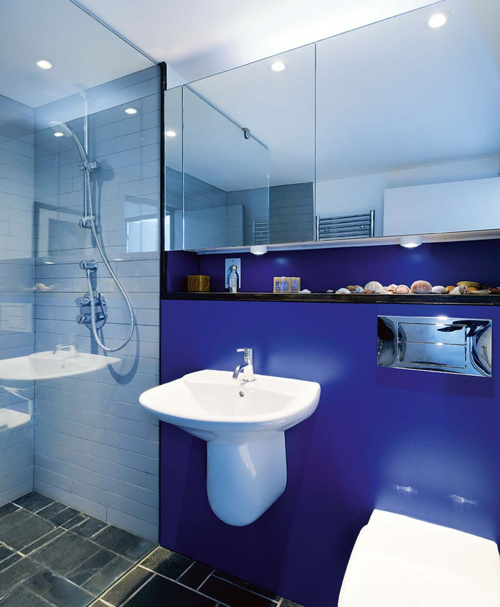 Blue bathroom in modernist self build