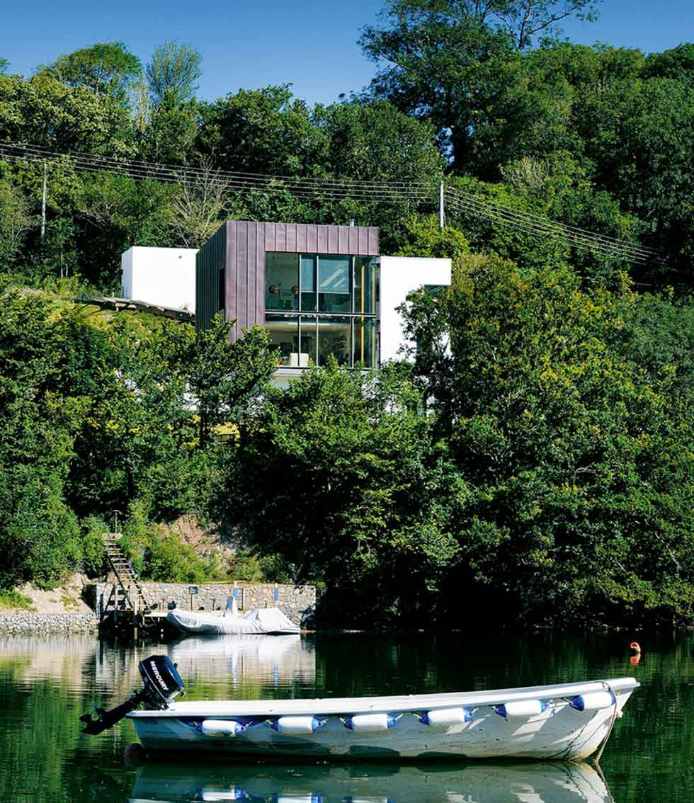 Modernist home on the banks of a river