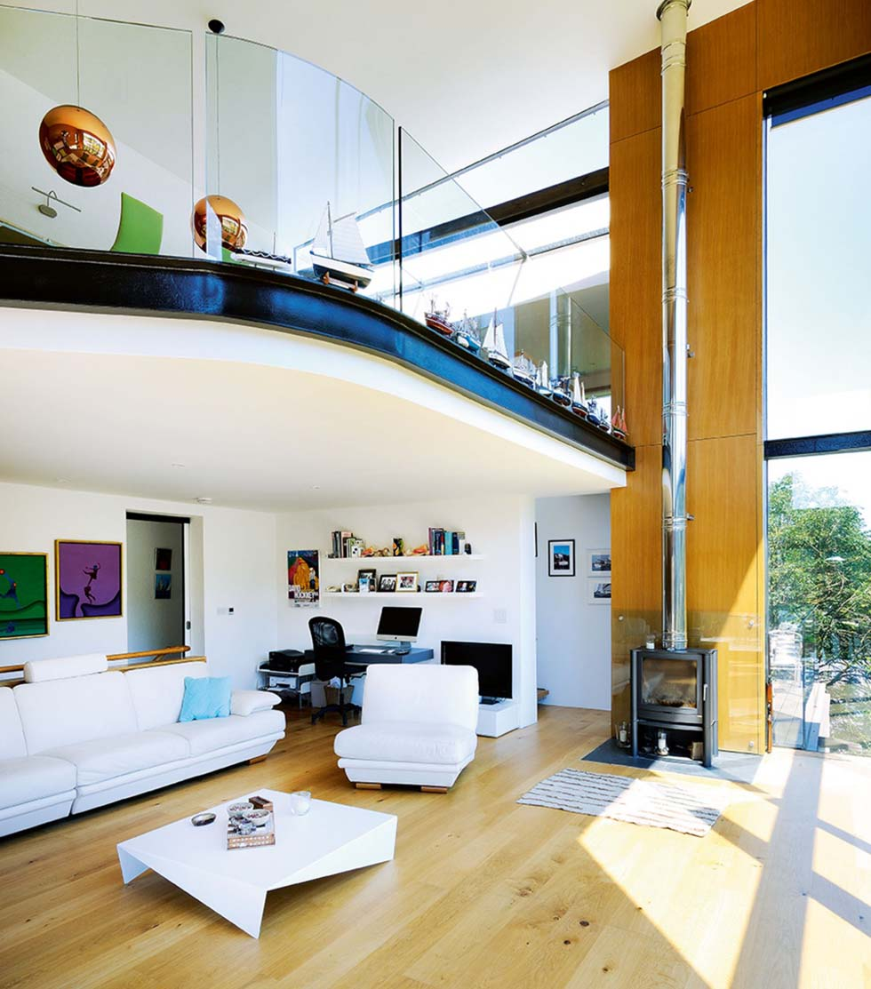 The double-height living space with mezzanine level