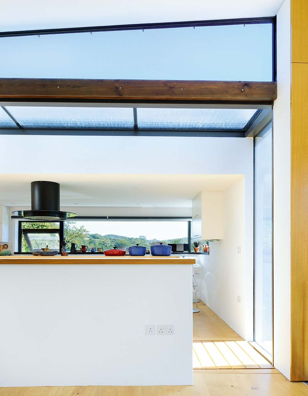 Glass panes bring natural light into the kitchen