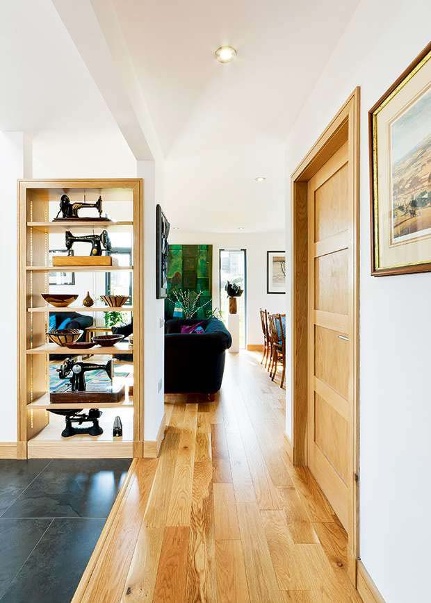 Shelving in the open plan space creates natural 'zones'