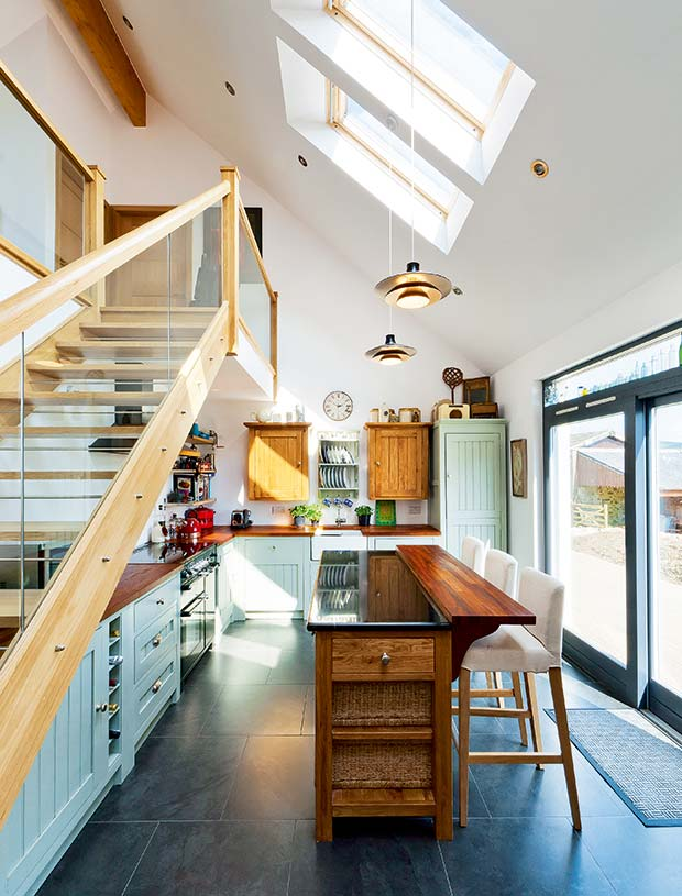The wooden open flight staircase in the kitchen