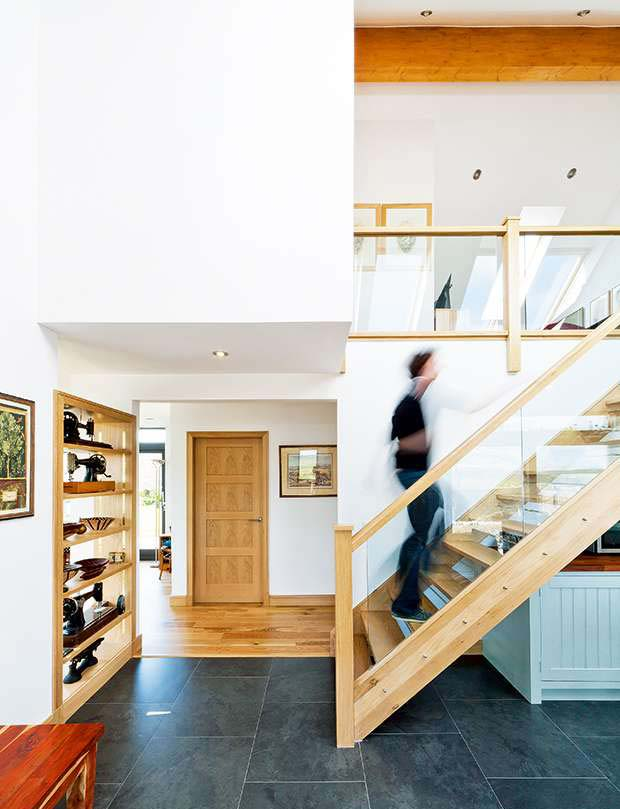 The open flight staircase in the double height kitchen