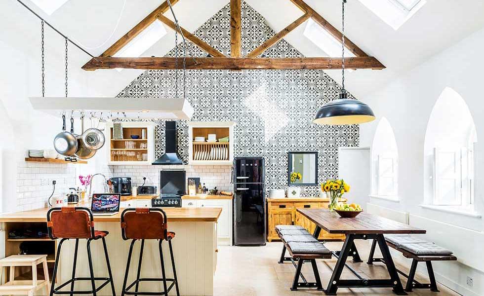 industrial style open plan kitchen in a chapel