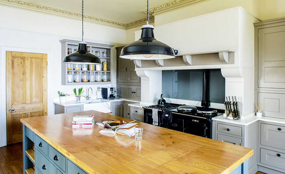 Victorian country house with kitchen island and pendant lamps