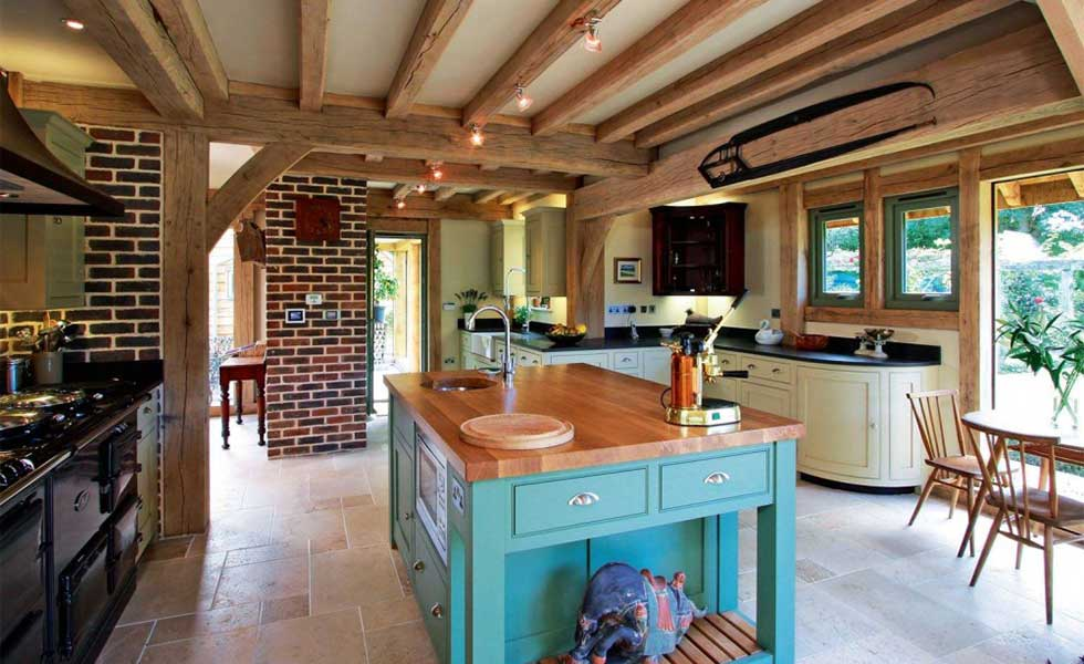 turquoise kitchen island in an oak frame kitchen
