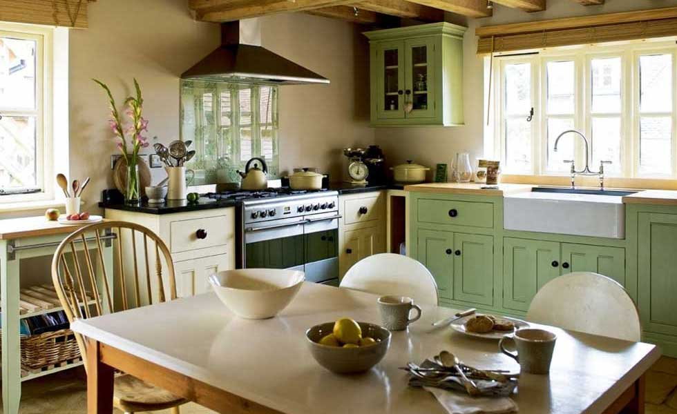 green kitchen cabinets in an oak frame farmhouse kitchen