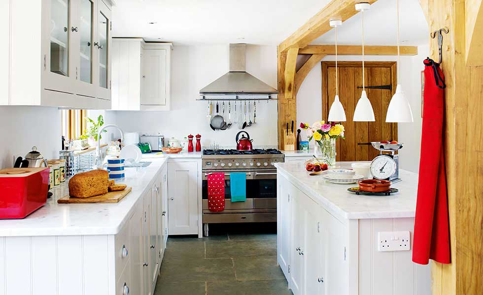 white country kitchen with red accessories