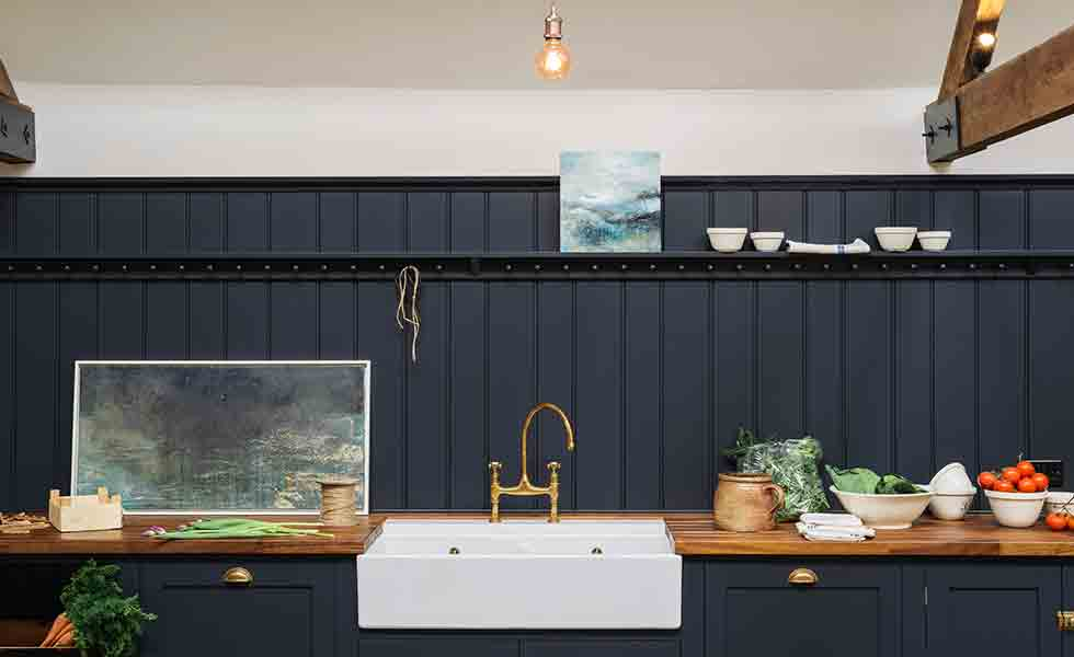 kitchen-with-traditional-butler-sink-and-bridge-tap