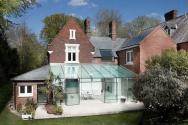A frameless galss extension on a Victorian house