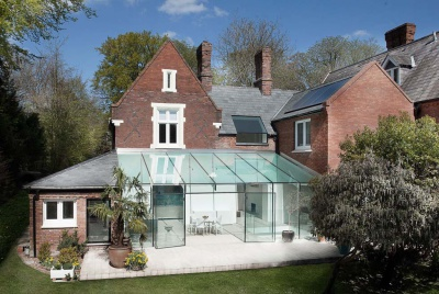 A frameless galss extension on a Victorian house