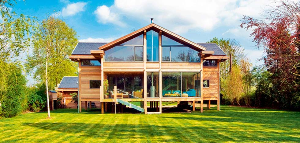 A home on stilts built next to the River Thames