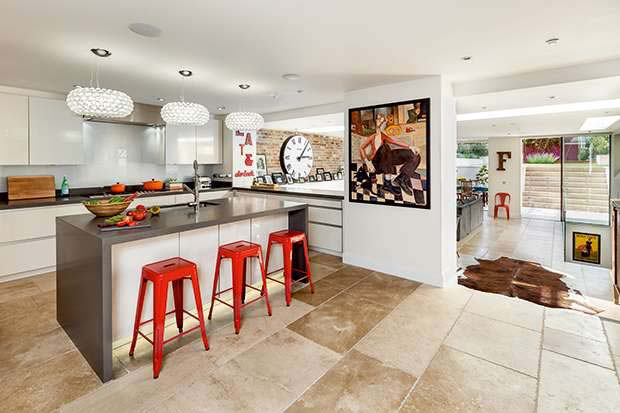 a contemporary kitchen with lots of accessories