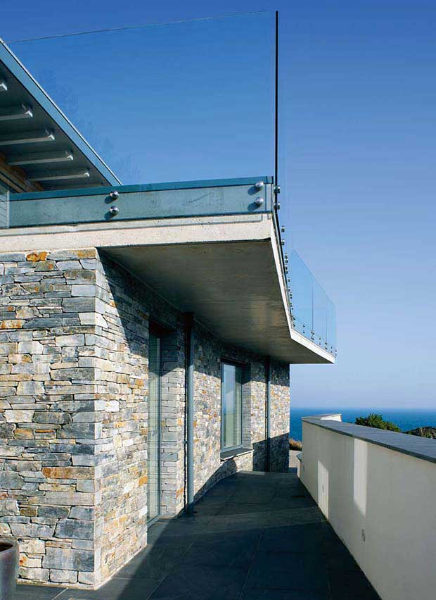 Glass balustrade acts as barrier on a roof terrace