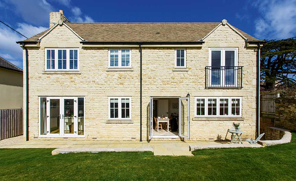 A Cotswold stone home with juliet balcony and french doors