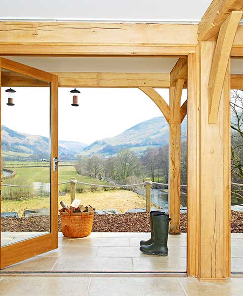 oak frame home in Wales entrance hall with views