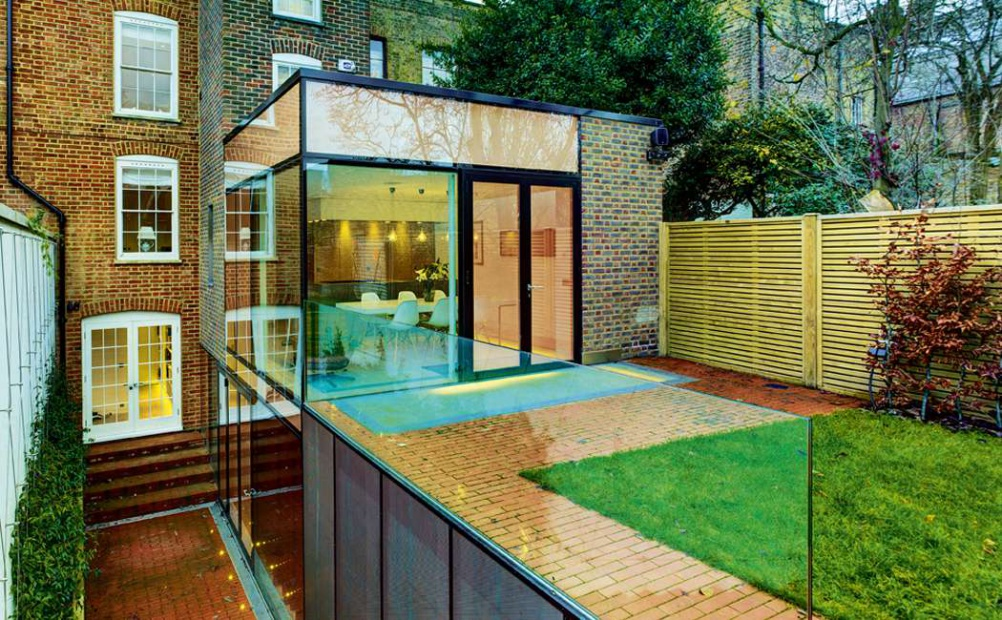 a Georgian home extended with a copper glass extension