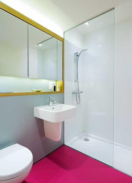 bathroom with pink rubber flooring