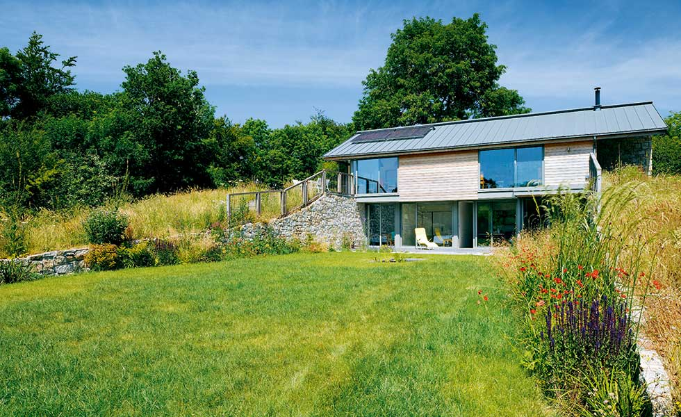 stone and timber clad sloping site home