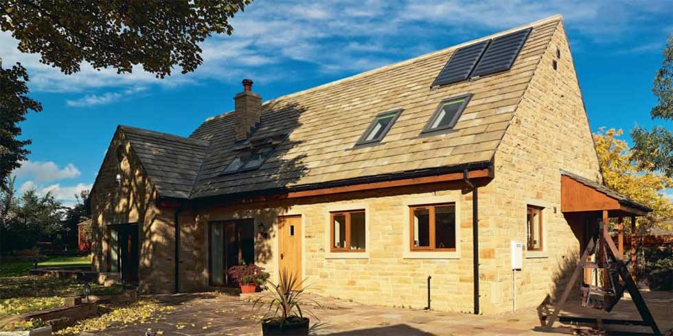 Eco self build house with solar panels on the roof