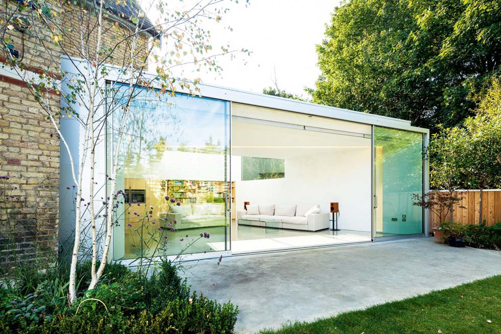 glass box style extension to Victorian home