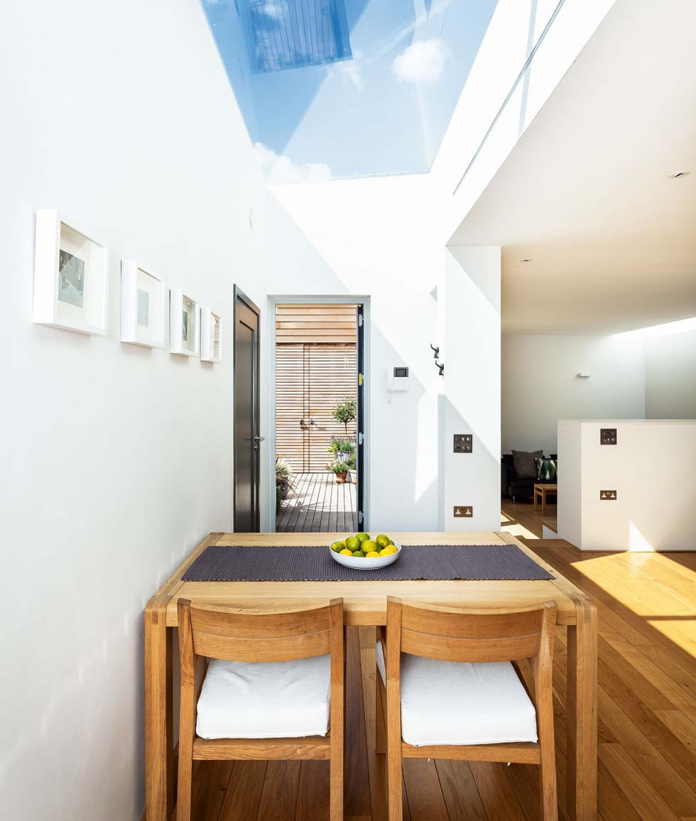 A large rooflight fills the kitchen with natural light