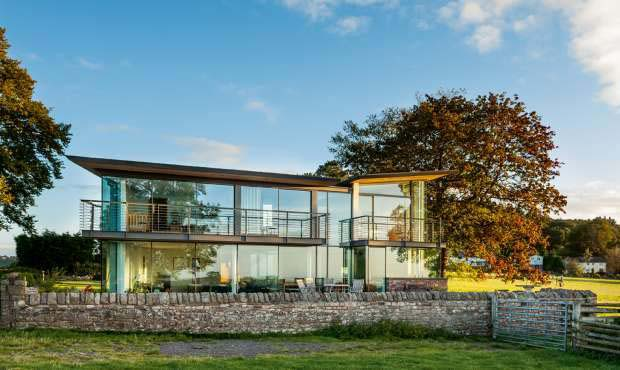 A stone and glass self build designed by Hall & Bednarczyk