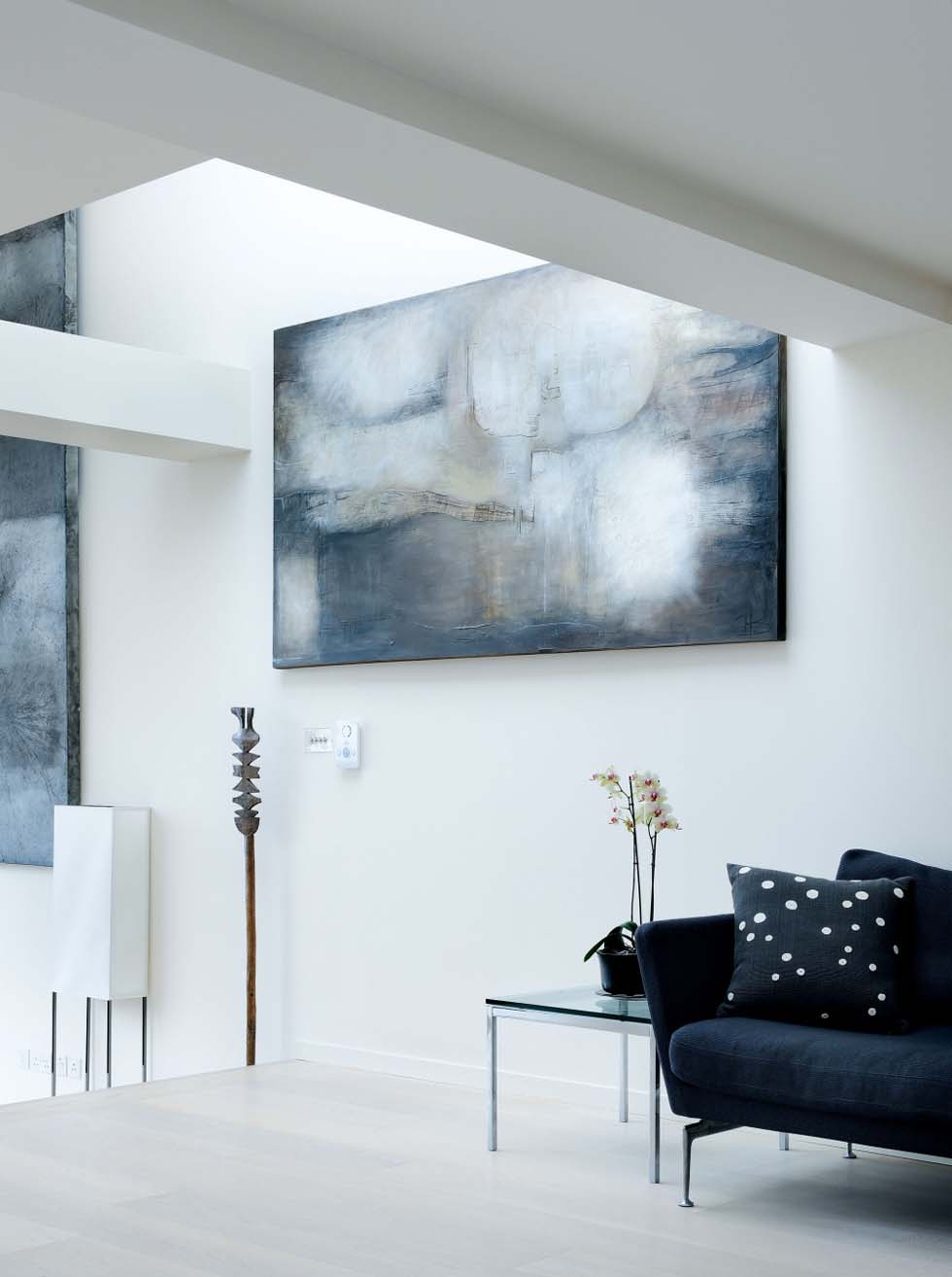 A painting acts as a focal point to this seating area