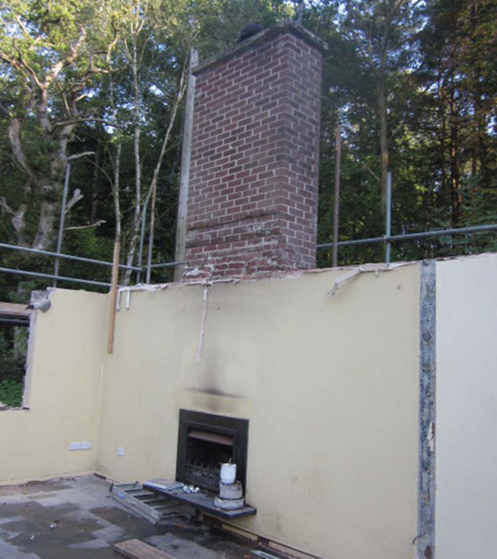 The chimney breast remains after the roof is removed