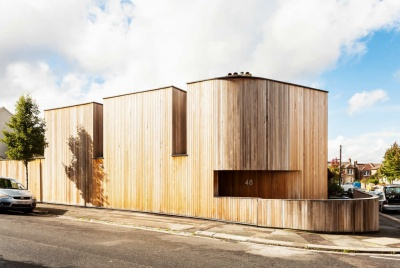 Cedar clad self build on a corner plot