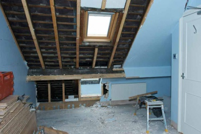 loft conversion with blue paint and old walls