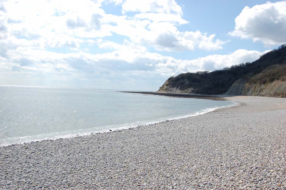 the bay three miles west of Lyme Regis