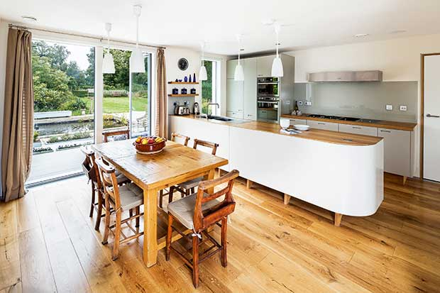 The large kitchen diner in the Wisa plywood home in Hertfordshire