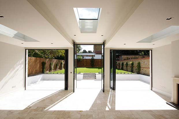 roof lights and bi-fold doors in a sunroom by IQ Glass