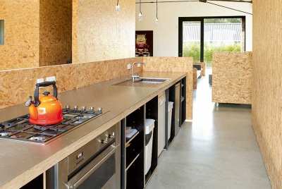 OSB kitchen in a barn conversion with polished concrete floor