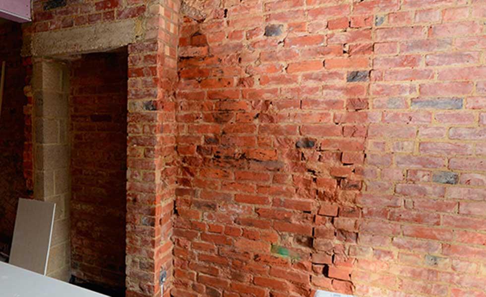 plastering a brick wall