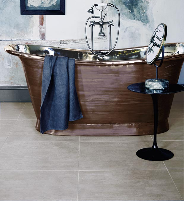 Barbican tiles from Fired Earth with a vintage brown freestanding bath