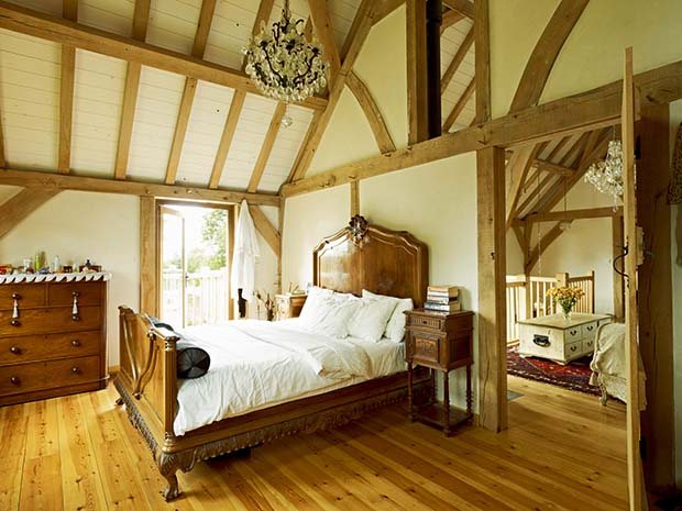 Oak frame home master bedroom with vaulted ceiling