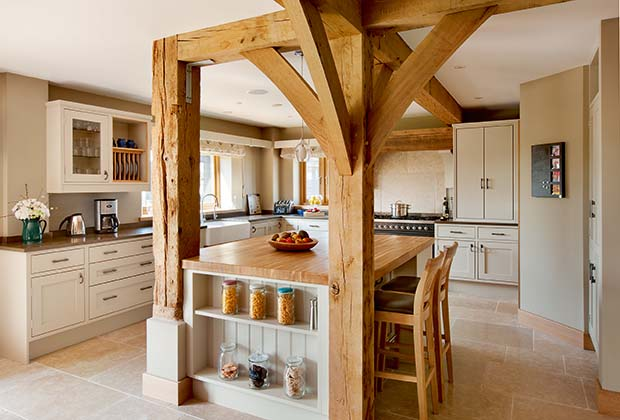 Contemporary country style kitchen with island and shaker style units in an oak frame home
