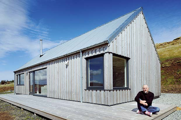 Nigel Rigden outside his self build modern holiday croft on the Isle of Skye