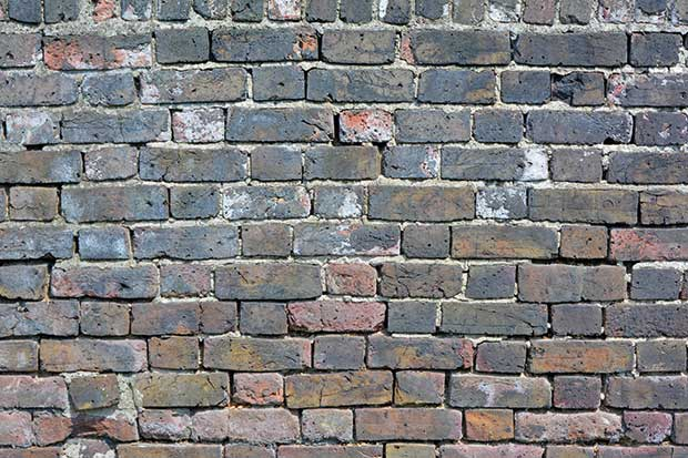 a wall in need of repointing repair work